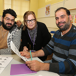 adult education tutor and students