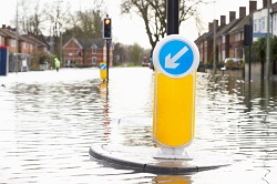 road sign on flooded road