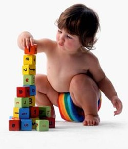 young child stacking building bricks
