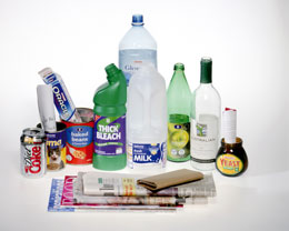 Mixed recyclables including bottles, boxes,tins, paper and jars.
