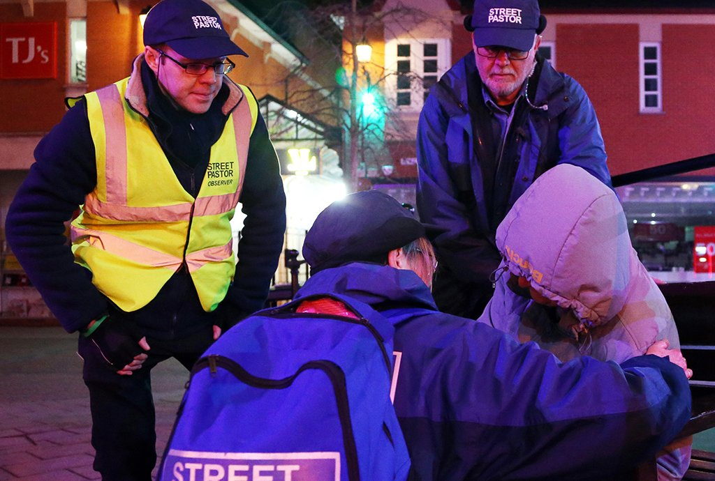 Chesterfield Street Pastors check on a potentially vulnerable adult asleep on a bench