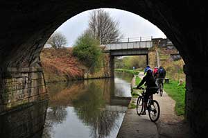 People cycling by Chesterfield canal