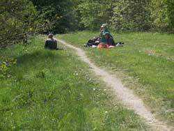 People sat beside a countryside path